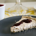 Vegan custard tart with oatmeal lavender crust and blueberry sauce
