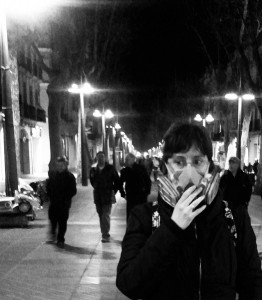 María, on the street with her mask